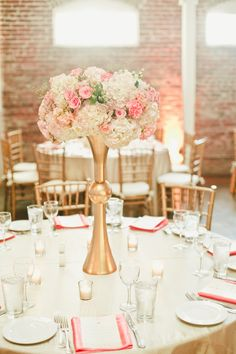 Modern Pink and White Centerpieces in Tall Gold Vessels | Onelove Photography | See More! http://heyweddinglady.com/pink-mint-and-gold-wedding-with-lots-of-sparkle/