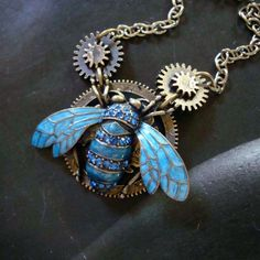Steampunk Industrial Necklace, Jeweled Bug Pendant, Gears and Chain, Royal Rhinestones. $34.00, via Etsy.