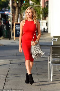 Dressed to impress: Abi Titmuss was sure to turn heads as she sat and waited for a date to...