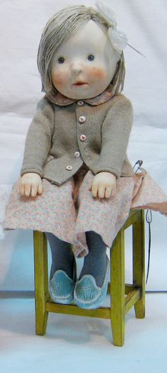 Paper Mache doll on a stool