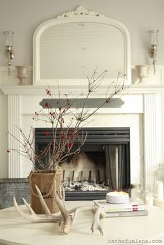 coffee table on casters, mirror and sconces above the fireplace