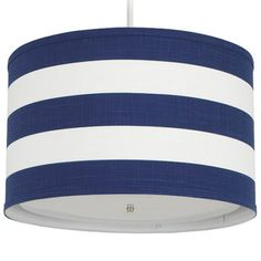"""Infuse your room in Oilo modern warmth and style while casting a soft glow with this pendant light. Its cylinder shade is handmade from cobalt blue and white striped woven cotton trimmed in white over acrylic. This light is custom made for you. Coordinates with the Oilo bedding products. Made in the USA. 20""""Dia x 12.5""""H Accepts 1 bulb, 60 watt max (not included) Cord set included; extends up to 55"""" Simple assembly Meets UL safety standards Requires hardwiring (professional installation…"""