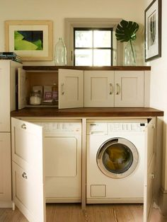 BHG: White front-load washer & dryer hidden behind white kitchen cabinets and butcher block ...