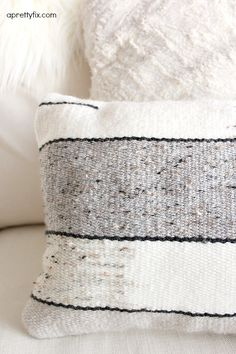 Create this DIY Woven Pillow with a basic loom, yarn, and pillow stuffing. A simple way to add a handmade touch to your home.