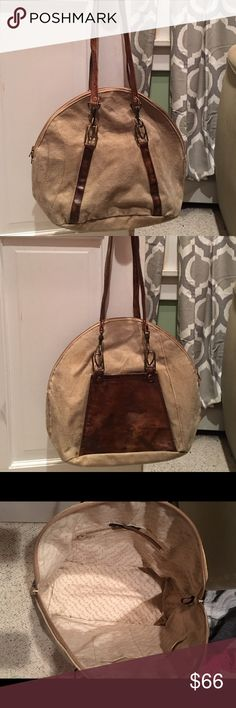 """NWOT Hand made canvas & leather handbag! NWOT Handmade canvas & leather handbag. Received as a gift, but never used. Exceptional craftsmanship with craftsman detailing! Subtle, yet very stylish. Ralph Lauren country style! Made by Mona B. 15"""" wide x 14"""" tall x 7"""" wide. Great size!!!!! Brown leather handles. PERFECT!!! Tan canvas with oil brushed leather trim. This is not a Ralph Lauren bag.... ralph lauren country Bags Shoulder Bags"""