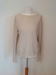 032032df36c Made in Italy, flattering top by reputable designer. The top has long  sleeves, is semi fitted and has a loose scoop neck which can be worn off  the shoulder.