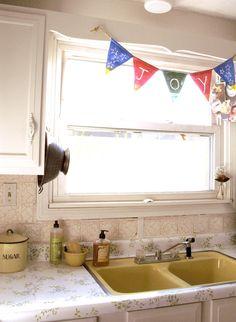 use hooks on cabinets above kitchen sink