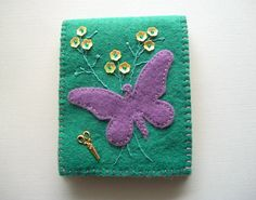 Teal Needle Book Felt Needle Organizer with Purple Butterfly and Yellow Flower Sequins  $23 Folded the case measures 8 x 10 cm or about 3.1 x 3.9 inches. You will have 8 pages ( 4 sheets) to organize and store your needles and pins.