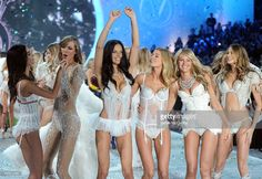 Models Lily Aldridge, Karlie Kloss, Adriana Lima, Doutzen Kroes, Candice Swanepoel, and Behati Prinsloo walk the runway at the 2013 Victoria's Secret Fashion Show at Lexington Avenue Armory on November 13, 2013 in New York City.