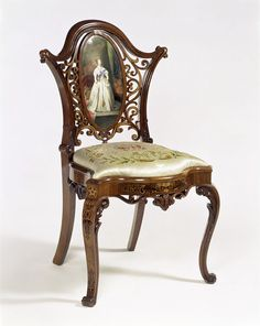 This chair was exhibited by Henry Eyles in Class XXVI (Furniture) in the Great Exhibition of 1851. The unconventional use of the porcelain plaque with the image of Queen Victoria, and the Royal Arms embroidered on the seat, demonstrated his creative skills as well as offering a form of homage to the monarch. This technical ingenuity and combination of unusual materials was typical of much of the furniture shown in 1851.