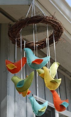 I like this idea for my baby mobile.. not sure how to make it a little more safe and able to hang near the crib though???