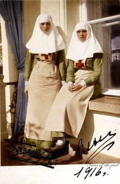 WW I Picture of Grand Ducheses Olga and Tatiana in their nurses uniforms