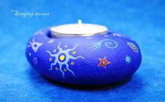 This stone candle holder is hand carved and hand painted.    I paint and draw all of my stones by hand with acrylic paints and with very thin