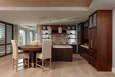 Integrating a table into the kitchen island is a great idea when you need seating in your kitchen, but also want to create a larger island as a focal point.