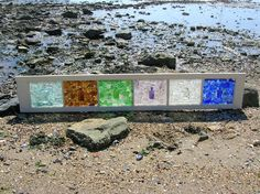 A nice way to add sea glass to your wall without it being a mosaic tile wall piece.
