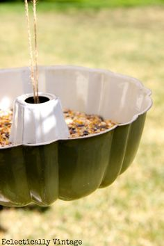 +Unique bird feeder out of an old bundt pan! ***Love this! I found the prettiest jello mould/bundt pan at the thrift store and I hooked some wire to it, filled it with bird seed and hung in in my tree. Super easy and adorable!!