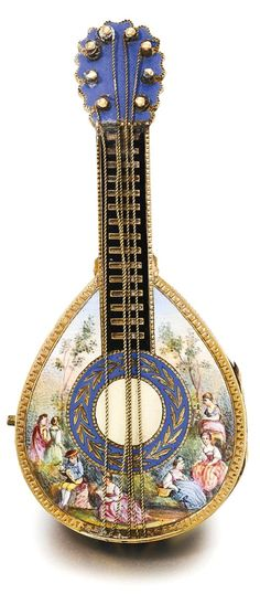 FRÈRES MELLY A YELLOW GOLD AND ENAMEL MANDOLIN-FORM WATCH CIRCA 1820 • gilt full plate cylinder movement, pierced and engraved balance bridge • concealed white enamel dial, Breguet numerals, blued steel moon hands • mandolin-form case with polychrome enamel scene depicting figures within a landscape, the hinged back with cream, black and translucent red enamel strips and engraved motifs • movement signed