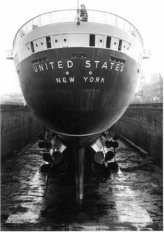 United States in drydock with an incredible view of her stern and propellers.