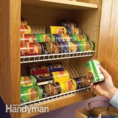 Add wire racks at an angle so that canned food rolls toward the front.