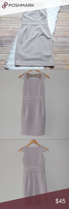 "BOGO 50% OFF | BANANA REPUBLIC Sheath Dress Classically simple dress. Cream and tan striped. Form fitting. Side zip. Polyester/cotton/spandex blend so has stretch. Size is 0 Petite.  Armpit: 15"" Waist: 13.5"" Hips: 17"" Shoulder to Hem: 34.5""  Instagram: @bringingupsuns Banana Republic Dresses Midi"