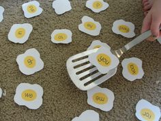 Easy egg flip game for teaching sight words. Say the word and child flips over the word when they find it. Adapt for phase by sound talking a word and child find word or word with particular sound in.
