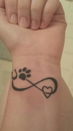 Gorgeous tattoo for the hound and horse lover. Paw print, horse shoe, heart and infinity sign.
