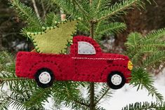 The vintage pickup truck carrying a tree is such a popular theme right now that I'm creating a Christmas wreath around this wood version I designed. It was only after I had it cut out and pai… Crafts Vintage Red Truck with Christmas Tree Christmas Tree Kit, Christmas Ornaments To Make, Christmas Sewing, Christmas Projects, Handmade Christmas, Holiday Crafts, Felt Projects, Christmas Felt Crafts, Christmas Red Truck