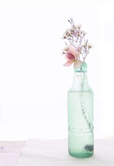 Guest Bedroom Decorative Vase - fresh-cut flowers in old glass bottles scattered around the room.