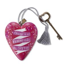 """""""No Friend Like a Sister"""", Art Heart. These limited edition sculpted hearts are individually designed by different artists. The artist's name appears on the back side of each Art Heart. Art Hearts can hang by their gold string or sit standing up with as the included key doubles as a stand"""
