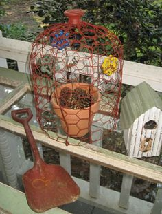 "Wire cloches were made with chicken Wire. First I made a tube, then I cut the top sections about every 3"". This was done so I could bend them in to make the dome. Then I used the wire ends and bent them back on themselves to tight and spray painted"