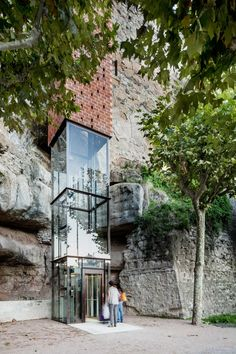 carles enrich urbanisme brick and glass elevator in gironella spain