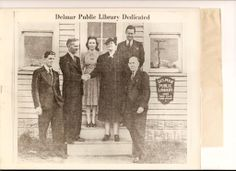 The first Delmar Public Library in 1940. Front row, left to right: Library Commissioner Frank Baker, Mayor Lockerman, President of the Library Commission Mrs. Ellis and Library Commissioner Dr. S. Howard Lynch.  Top row, left to right: Librarian Mrs. Frank Baker and Commissioner Cecil Ford, Principal of Delmar Schools. Library Commissioner Dr. H.E. Lecates was unable to attend.