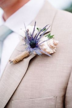 Beach wedding boutonniere idea -unique seashell boutonniere with purple flower {Norman Photography and Paperie}