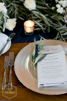 table setting using olive branches at a rustic warehouse wedding at Sodo Park.