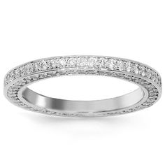This lovely womens diamond eternity band is crafted in highly polished 14K White Gold. Numerous small round cut diamonds are placed all around the band and total to 1.97 carats. The frame measures to 1/8 Inches in width and weighs approximately 3.2 grams. This elegant womens diamond eternity band is an ideal gift for that special occasion. $2,669.00