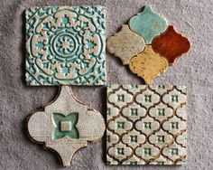 This tiles is handpainted in a beautiful jade and brown glazes on a rustic background and has a somewhat vintage look. They can be feature