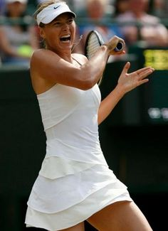 Maria Sharapova slugs a forehand in a white Nike tennis dress at Wimbledon 2010