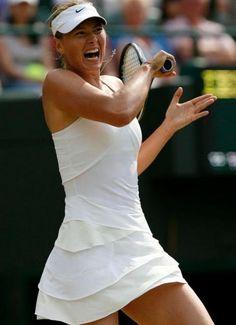 Maria Sharapova slugs a forehand in a white Nike tennis dress at Wimbledon 2010