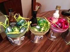 Adult Easter Baskets... Favorite booze, shot glass and chocolate with initials on the tin! Make Easter a little fun this Year! - More adult Easter basket inspiration on LiveLifeWellBlog.com