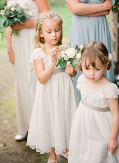 Very, very cute and pretty. Love the fabrics, the high ribbons and those little sleeves :) In April we'd definitely have to think of keeping the girls warm enough if they had such thin dresses, though (tights? cardie?)