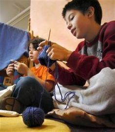 Teaching children how to knit! Good idea for a school club, keeping antsy kids busy if they finish work early, or for class projects for school auctions to raise money, or to give to the homeless or elderly.