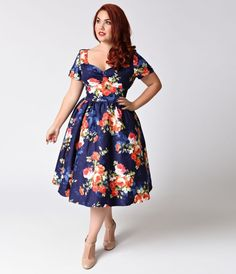 Only boring people are bored, dears. Freshly cut in a chic 1950s style comes The Draper Dress from Unique Vintage! A captivating navy blue plus size swing dress with a dash of stretch and vibrant blooming floral print that radiates vintage charm, boasting