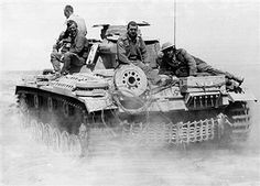 2.WW, North africa, war theater (Africa campaign) , german africa corps Feb.41-May43:a german tank (III) in the desert near Tobruk driving back to rear lines. Sittin above three captured british soldiers and a german tank crew member. June 1941 - pin by Paolo Marzioli