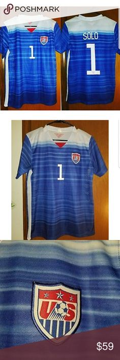 "USWNT GOALIE HOPE SOLO JERSEY(2016) BREAST CANCER REPLICA HOPE SOLO JERSEY(THE HOT GOALIE, SRSLY SHES HOTT, GOOGLE HER)  3 STARS IN USA PATCH REPRESENT TRHE 3 WORLD CUPS THAT USAWNT HAD IN 2016   #1 ON BACK IS OUTLINED IN PINK(FOR BREAST CANCER )  Measurements Pit to pit=20"" Length=25"" Sleeve(from collar edge to SLEEVE edge at bicep area)=12""  PREOWNED IN EXCELLENT GENTLY USED CONDITION. VERY SMALL BLACK SPOT NEAR LEFT SIDE COLLAR, MAY COEM OUT IN WASH, SHOWN IN PHOTO NEAR THE END OF THE…"
