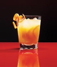Bourbon Ginger Snap - A cup of honey sweetens this delectable concoction made from lemon juice, orange juice, pear nectar, and fresh ginger.