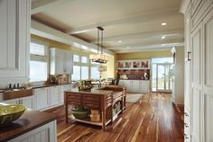 A touch of traditional beadboard styling goes timeless with light colors, clean lines and an airy layout.