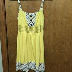 Dress Yellow cotton dress with blue and brown color combo. Brown buttons on the front. Size small from Charlotte Russe. Barely worn. Would look super cute with a jean jacket! Charlotte Russe Dresses Mini