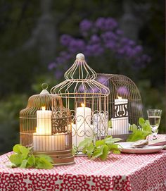 A trio of flea market birdcages serves as a candle-corralling centerpiece.  - GoodHousekeeping.com