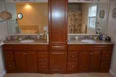 The master bath has double sinks and a whirlpool bath.