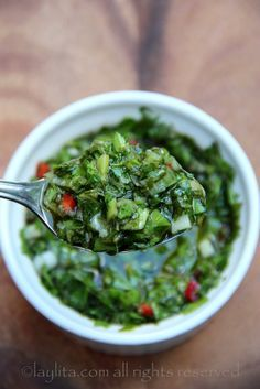 Traditional chimichurri recipe made with parsley, oregano, garlic, onion, red pepper, vinegar and olive oil.